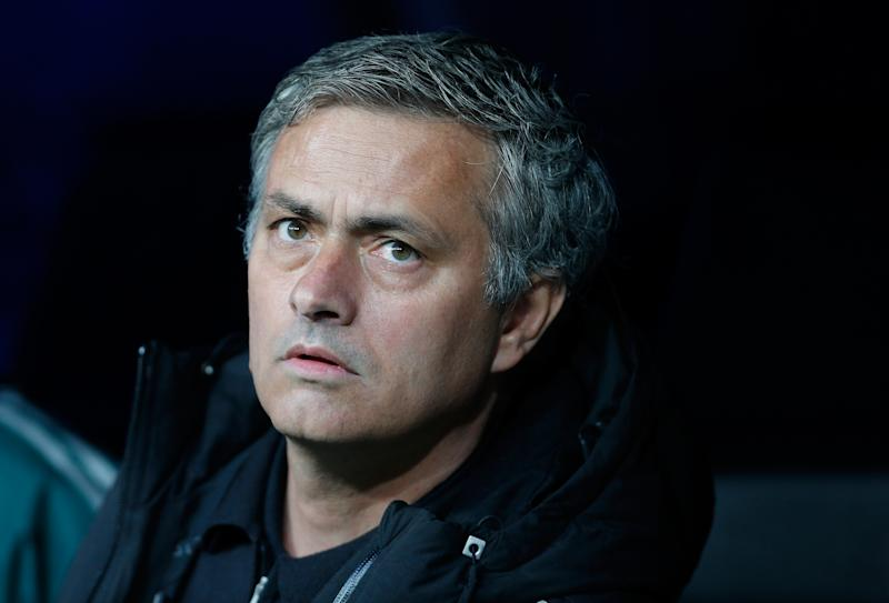 Real Madrid's coach Jose Mourinho from Portugal look from the bench before the start of the Champions League semifinal second leg soccer match between Real Madrid and Borussia Dortmund at the Santiago Bernabeu stadium in Madrid, Spain, Tuesday April 30, 2013. (AP Photo/Paul White)