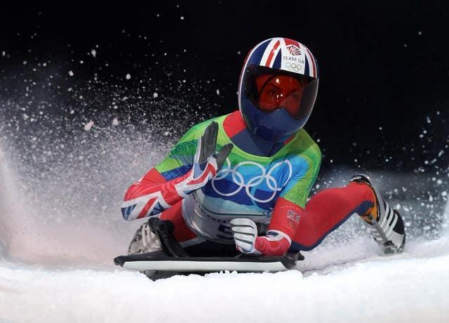 Great Britain's Amy Williams crosses the line to win the Women's Skeleton at Whistler Sliding Centre