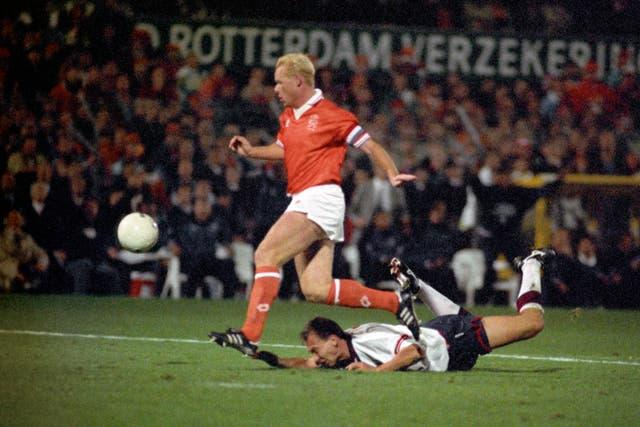 England's David Platt on the ground after being hauled back by Holland's Ronald Koeman