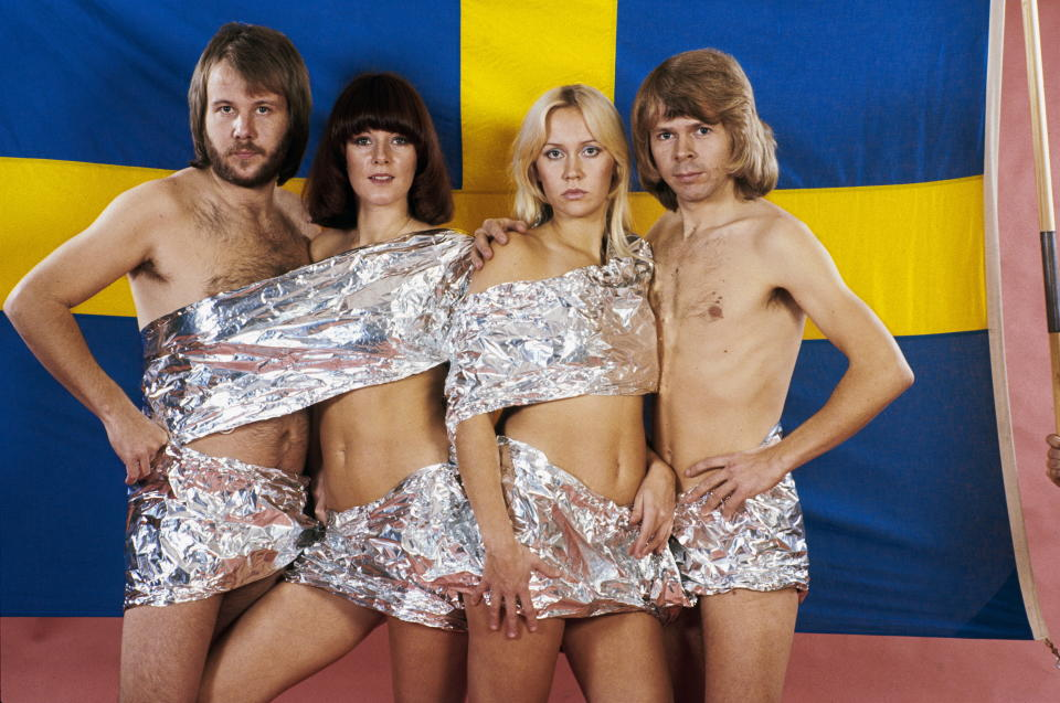 Members of Swedish band ABBA wrapped in tin foil.