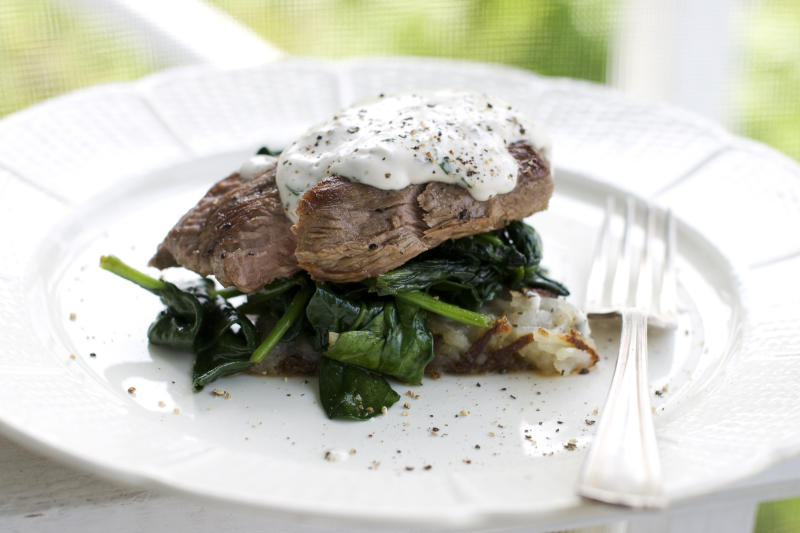In this image taken on May 20, 2013, a Father's Day steakhouse dinner is shown served on a plate in Concord, N.H. (AP Photo/Matthew Mead)