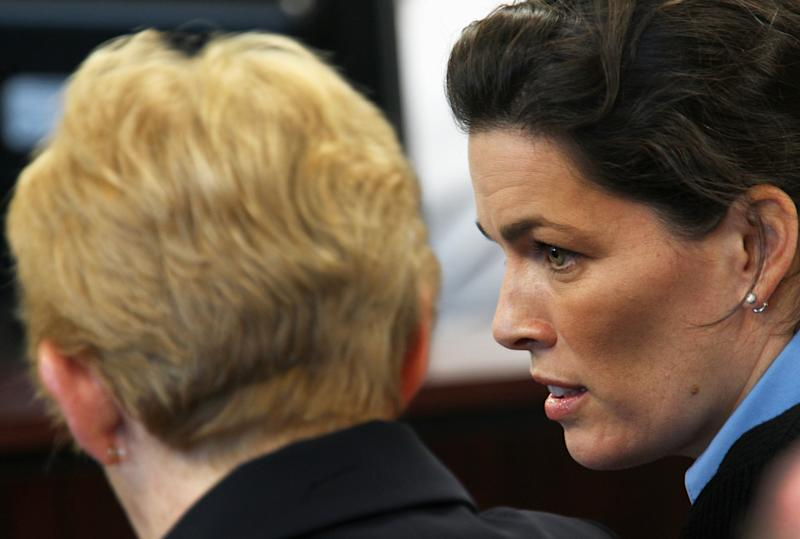 **CORRECTS NAME OF BRENDA KERRIGAN** Former Olympic skater Nancy Kerrigan, right, and her mother Brenda Kerrigan appear in court for the trial of her brother Mark Kerrigan at Middlesex Superior Court Thursday, May 19 2011 in Woburn, Mass. Kerrigan is charged with manslaughter in the January 2010 death of his father, Daniel Kerrigan. (AP Photo/Wendy Maeda, Pool)