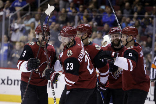 FILE - In this March 31, 2018, file photo, Arizona Coyotes defenseman Oliver Ekman-Larsson (23) celebrates with teammates after scoring in the second period during an NHL hockey game against the St. Louis Blues, in Glendale, Ariz. Ekman-Larsson watched Shane Doan lead the Arizona Coyotes for seven seasons before the captain retired in 2017. Now, after signing an eight-year contract extension to remain in the desert, Ekman-Larsson is poised to take over a primary leadership role. (AP Photo/Rick Scuteri, File)
