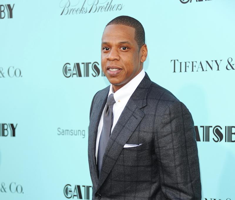"FILE - In this May 1, 2013 file photo, Jay-Z attends ""The Great Gatsby"" world premiere at Avery Fisher Hall in New York. The rapper released his 12th album, ""Magna Carta Holy Grail,"" three days early on Thursday, July 4, 2013, through a deal with Samsung. The album is officially out Sunday and features Justin Timberlake, Beyonce, Frank Ocean and Timbaland. (Photo by Evan Agostini/Invision/AP, File)"