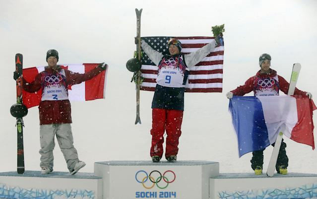 Gold medalist David Wise of the United States, center, celebrates with silver medalist Mike Riddle of Canada, left, and bronze medalist Kevin Rolland of France, after the men's ski halfpipe final at the Rosa Khutor Extreme Park, at the 2014 Winter Olympics, Tuesday, Feb. 18, 2014, in Krasnaya Polyana, Russia. (AP Photo/Sergei Grits)