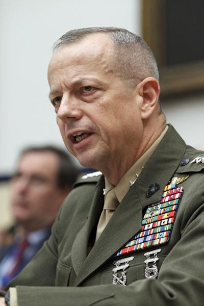 FILE - In this March 20, 2012 file photo, Marine Gen. John Allen, the top U.S. commander in Afghanistan testifies on Capitol Hill in Washington. Allen said Thursday he prefers a robust U.S. combat force of 68,000 in 2013, signaling a potential halt in the drawdown and complicating any effort by President Barack Obama to accelerate the timetable after more than a decade of war. (AP Photo/J. Scott Applewhite, File)