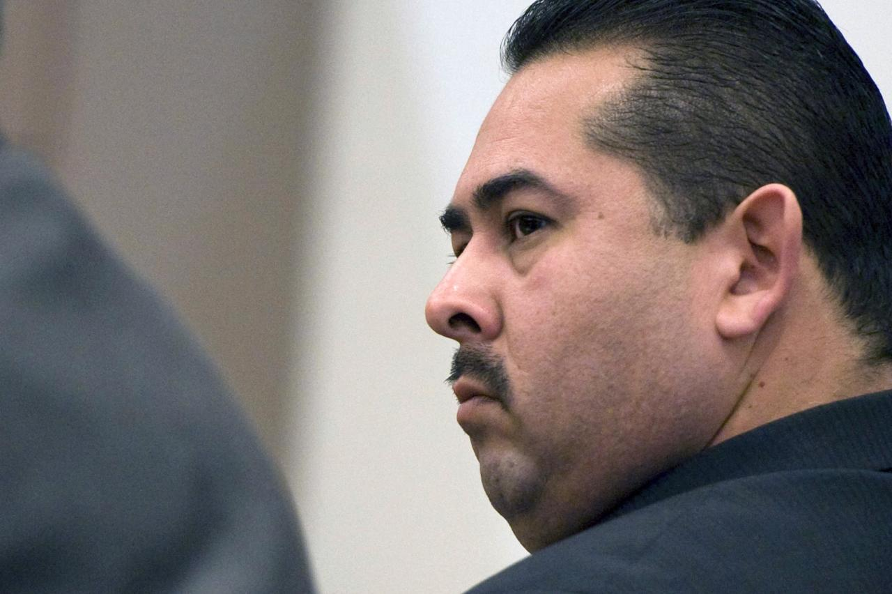Former Fullerton police officer Manuel Ramos listens to closing arguments in the second degree murder case against him and fellow former officer Jay Cicinelli in Santa Ana, California January 9, 2014. Jurors began deliberating in the trial of two former California policemen Thursday in the 2011 beating death of Kelly Thomas that touched off protests and political upheaval in the Los Angeles suburb of Fullerton. REUTERS/Joshua Sudock/Pool (UNITED STATES - Tags: CRIME LAW)