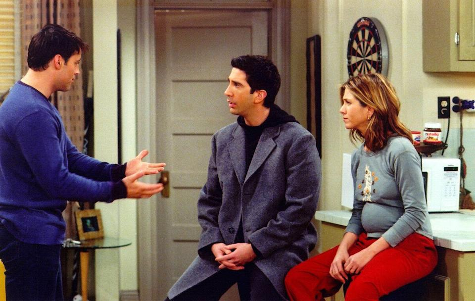 Actors Matt Le Blanc (L), David Schwimmer (C) and Jennifer Aniston are shown in a scene from the NBC series 'Friends'. The series received 11 Emmy nominations, including outstanding comedy series, by the Academy of Television Arts and Sciences July 18, 2002 in Los Angeles, California.  (Photo by Warner Bros. Television/Getty Images)