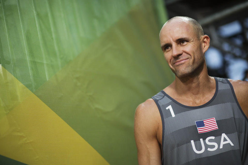 FILE - In this Aug. 8, 2016, file photo, Jake Gibb, of the United States, waits to be introduced to the crowd for a men's beach volleyball match against Austria at the Summer Olympics in Rio de Janeiro, Brazil. Since the spread of coronavirus, high-stakes events in China have been postponed until after the Summer Games or canceled outright; more are in jeopardy, and the five-star World Tour Finals are in Italy, another focus of the outbreak. (AP Photo/David Goldman, File)
