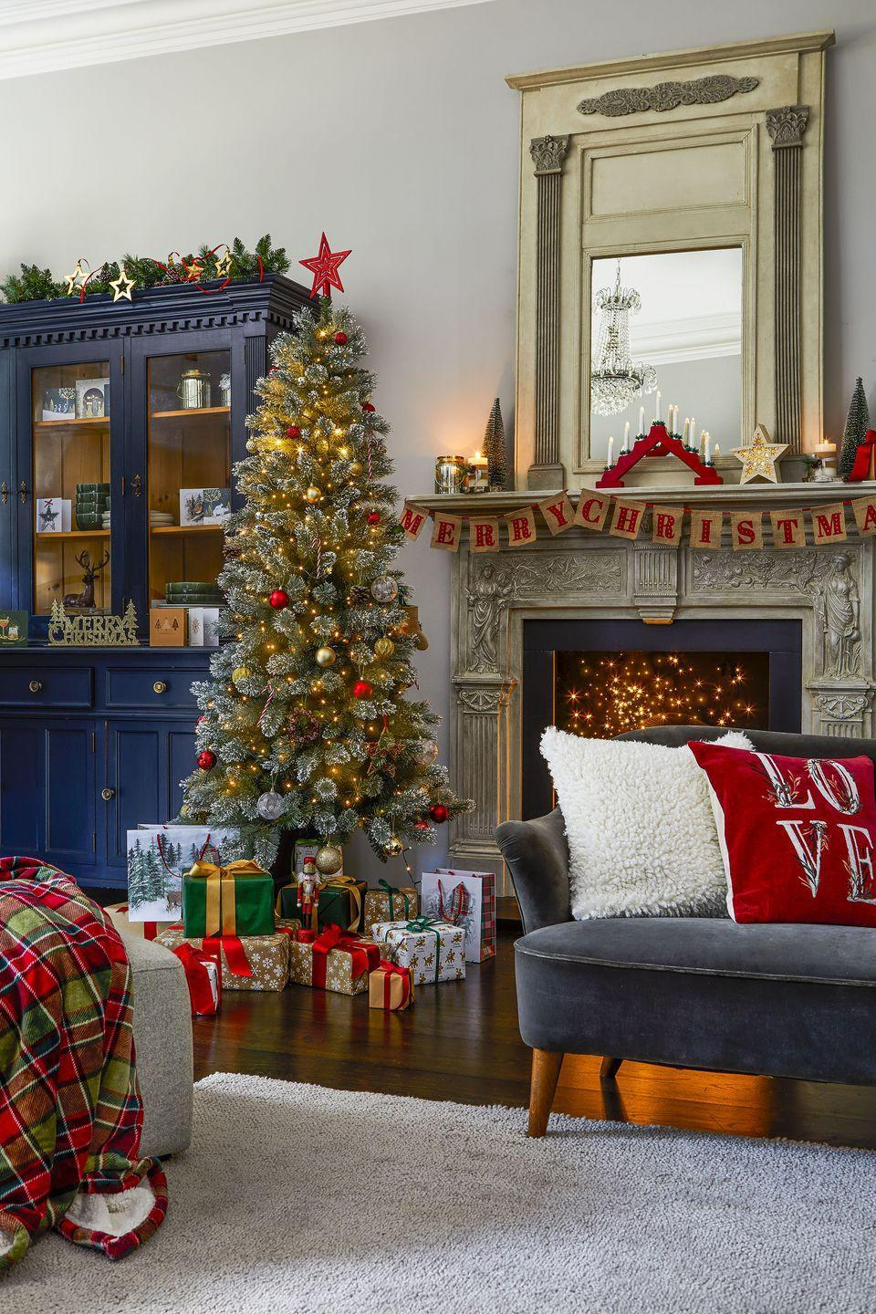 """<p>Keep it classic this year with traditional tones of red, green and gold. As part of Tesco's Forest Greens trend, you'll find hessian bunting (£5), a tartan sherpa throw (£20), <a href=""""https://www.housebeautiful.com/uk/lifestyle/shopping/g313/christmas-cushions-for-home/"""" rel=""""nofollow noopener"""" target=""""_blank"""" data-ylk=""""slk:Christmas cushions"""" class=""""link rapid-noclick-resp"""">Christmas cushions</a> (£10), plus an on-trend <a href=""""https://www.housebeautiful.com/uk/decorate/display/a31904667/drinks-trolley-bar-cart/"""" rel=""""nofollow noopener"""" target=""""_blank"""" data-ylk=""""slk:drinks trolley"""" class=""""link rapid-noclick-resp"""">drinks trolley</a> (£40). </p><p>'The Tesco Drinks Trolley is both incredibly stylish and practical,' the supermarket says. 'With a sleek golden metal frame, glass shelving, and wheels for smooth mobility around the party, this is a must-have for festive entertaining this season.'<br></p>"""