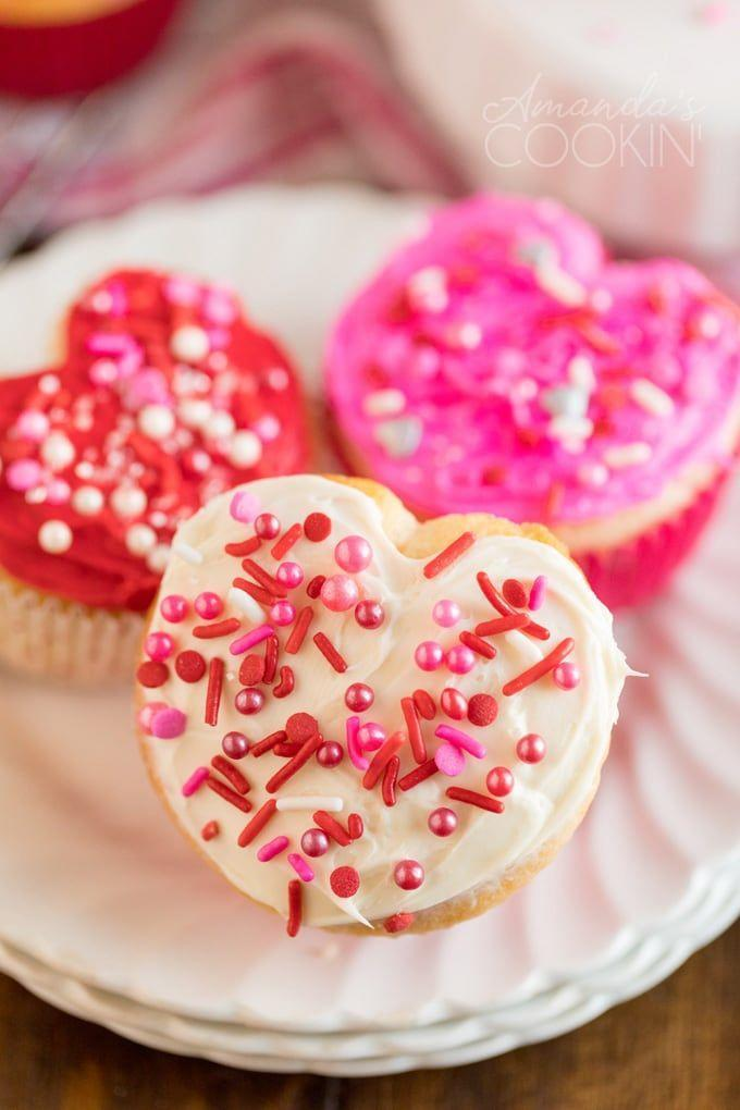 """<p>This blogger has a clever hack for getting your cupcakes heart shaped. Your kids will love them.</p><p><strong>Get the recipe at <a href=""""https://amandascookin.com/valentine-cupcakes/"""" rel=""""nofollow noopener"""" target=""""_blank"""" data-ylk=""""slk:Amanda's Cookin'"""" class=""""link rapid-noclick-resp"""">Amanda's Cookin'</a>.</strong></p><p><strong><a class=""""link rapid-noclick-resp"""" href=""""https://go.redirectingat.com?id=74968X1596630&url=https%3A%2F%2Fwww.walmart.com%2Fsearch%2F%3Fquery%3Dcupcake%2Bpans&sref=https%3A%2F%2Fwww.thepioneerwoman.com%2Ffood-cooking%2Fmeals-menus%2Fg35139389%2Fvalentines-day-cupcake-ideas%2F"""" rel=""""nofollow noopener"""" target=""""_blank"""" data-ylk=""""slk:SHOP CUPCAKE PANS"""">SHOP CUPCAKE PANS</a><br></strong></p>"""
