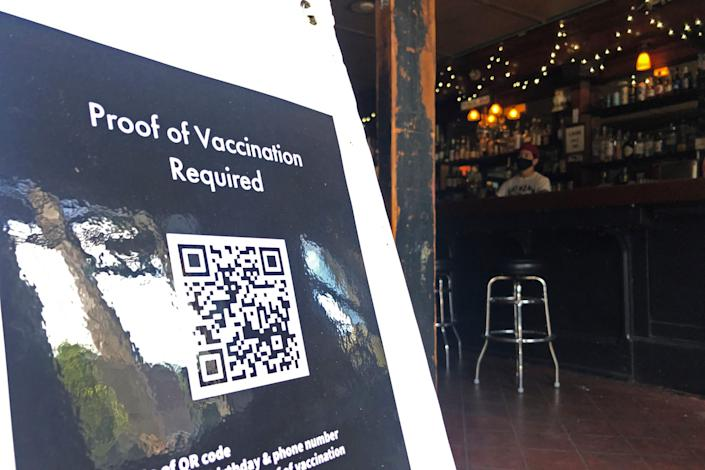 A proof of vaccination sign is posted at a bar in San Francisco on Thursday, July 29, 2021.