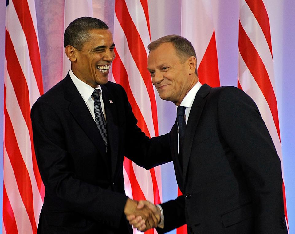Polish Prime Minister Donald Tusk (R) shakes hands with U.S. President Barack Obama during their meeting in Warsaw on May 28, 2011.