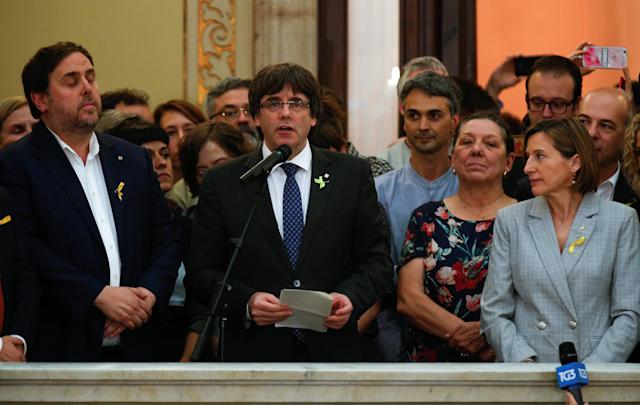 <p>Catalan President Carles Puigdemont speaks during a ceremony after the Catalan regional Parliament declared independence from Spain in Barcelona, Spain, Oct. 27, 2017. (Photo: Albert Gea/Reuters) </p>