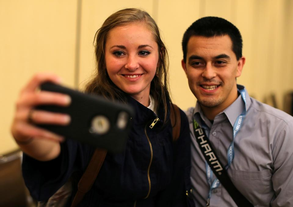 Millennial stock blogger and trader Rachel Fox is asked to take a picture with a fan after speaking to a group of investors, tech nerds and stock traders at StockTwits annual Stocktoberfest in Coronado, California. Photo: REUTERS/Mike Blake