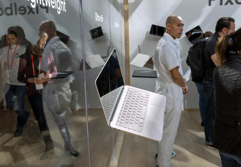 FILE - In this Oct. 15, 2019, file photo a Google Pixelbook Go hangs in the air as it is displayed at an event as Google announced this and other new devices in New York. Alphabet Inc., parent company of Google reports financial earns on Monday, Oct. 28. (AP Photo/Craig Ruttle, File)