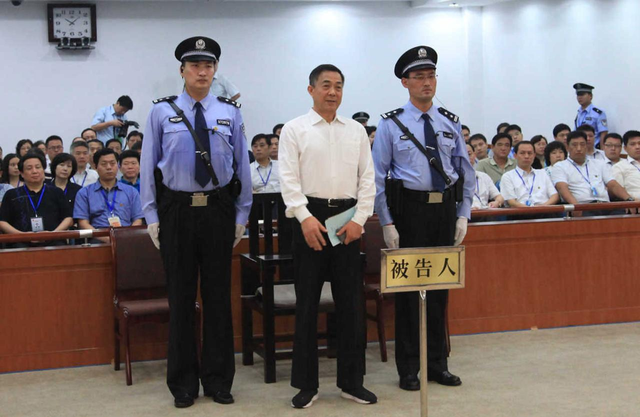 Ousted Chinese politician Bo Xilai (C) listens to his verdict inside the court in Jinan, Shandong province September 22, 2013, in this photo released by Jinan Intermediate People's Court. The court sentenced former Chongqing Municipality Communist Party Secretary Bo to life in prison on Sunday after finding him guilty of all the charges he faced of corruption, taking bribes and abuse of power. REUTERS/Jinan Intermediate People's Court/Handout via Reuters (CHINA - Tags: POLITICS CRIME LAW TPX IMAGES OF THE DAY) 