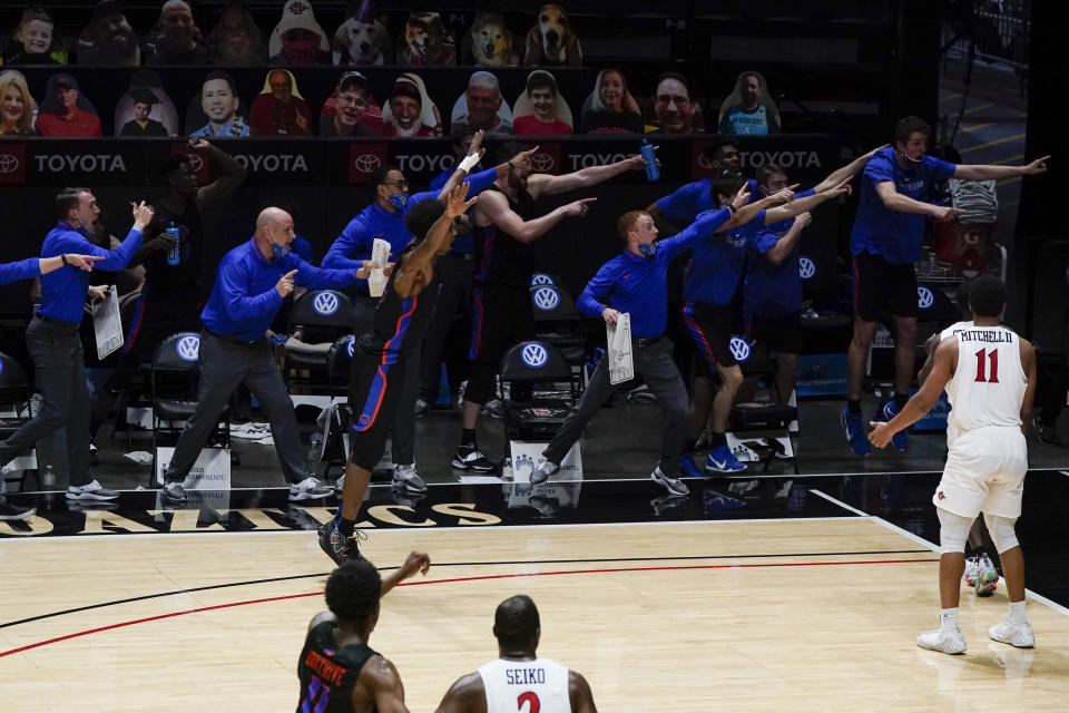 Boise State players and coaches signal that they had possession of the ball during the second half of an NCAA college basketball game against San Diego State, Thursday, Feb. 25, 2021, in San Diego. (AP Photo/Gregory Bull)