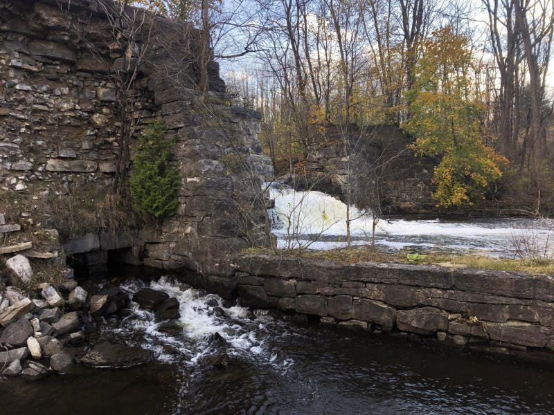 FILE - This Nov. 6, 2019, file photo shows the Harrower Pond Dam in Amsterdam, N.Y. U.S. Sen. Kirsten Gillibrand, D-N.Y., is proposing Tuesday, Dec. 17, 2019, to boost federal efforts to fortify the nation's dams following an Associated Press investigation that found scores of potentially troubling dams around the country. (AP Photo/Mary Esch, File)