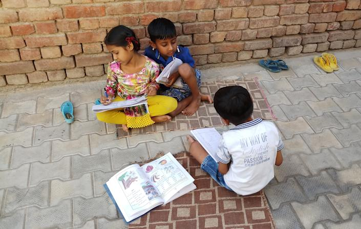 RAJPURA, INDIA - NOVEMBER 28, 2019 : Indian children study on the street in Rajpura town of district Patiala in Punjab, India. - PHOTOGRAPH BY Saqib Majeed / Barcroft Media (Photo credit should read Saqib Majeed / Barcroft Media via Getty Images)