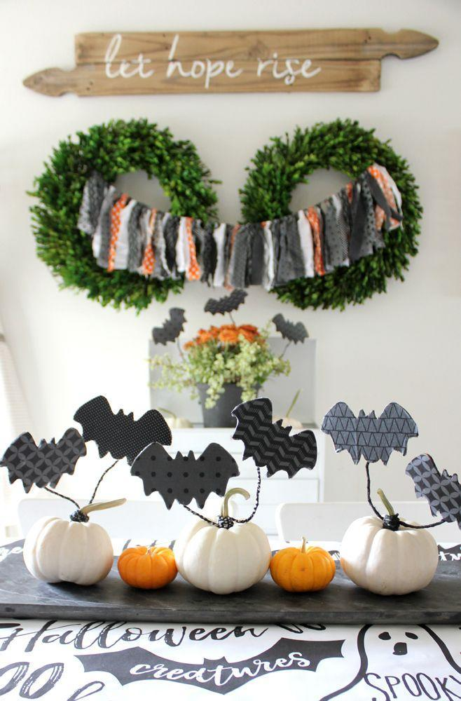 """<p>Make mini pumpkins feel extra festive with black paper bats you can craft in just a few minutes.</p><p><strong>Get the tutorial at <a href=""""http://eighteen25.com/2017/09/diy-flying-decoupage-bats/"""" rel=""""nofollow noopener"""" target=""""_blank"""" data-ylk=""""slk:Eighteen25"""" class=""""link rapid-noclick-resp"""">Eighteen25</a>.</strong></p><p><a class=""""link rapid-noclick-resp"""" href=""""https://www.amazon.com/Unfinished-Shape-Variety-Sizes-Halloween/dp/B0119T3VEW/?tag=syn-yahoo-20&ascsubtag=%5Bartid%7C10050.g.3739%5Bsrc%7Cyahoo-us"""" rel=""""nofollow noopener"""" target=""""_blank"""" data-ylk=""""slk:SHOP WOOD BAT SHAPES"""">SHOP WOOD BAT SHAPES</a> </p>"""