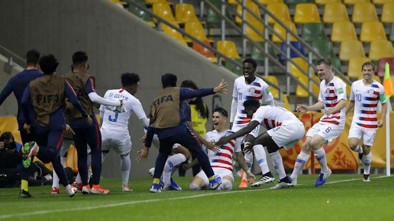 U.S. scores two late goals to upset France in the round of 16