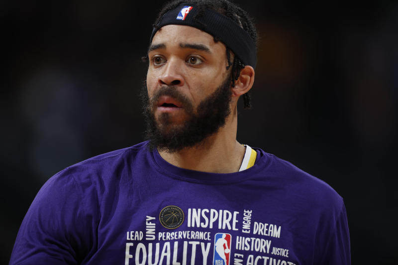 Profile shot of Los Angeles Lakers center JaVale McGee in a purple NBA warm-up shirt.