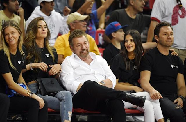 """Knicks owner James Dolan, middle, attends a Las Vegas summer league game July 7. He is the first owner in the NBA known to have tested positive for the coronavirus. <span class=""""copyright"""">(Ethan Miller / Getty Images)</span>"""