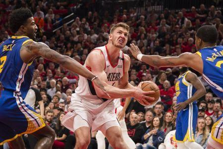 May 20, 2019; Portland, OR, USA; Portland Trail Blazers forward Meyers Leonard (11) drives to the basket against Golden State Warriors forward Jordan Bell (2) and forward Alfonzo McKinnie (28) during the first half in game four of the Western conference finals of the 2019 NBA Playoffs at Moda Center. Mandatory Credit: Troy Wayrynen-USA TODAY Sports