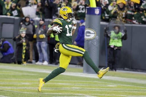 Green Bay Packers' Davante Adams runs to the endzone for his touchdown catch during the second half of an NFL divisional playoff football game against the Seattle Seahawks Sunday, Jan. 12, 2020, in Green Bay, Wis. (AP Photo/Darron Cummings)