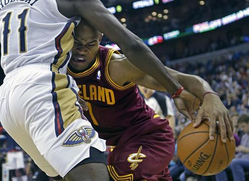 Cleveland Cavaliers point guard Jarrett Jack (1) drives to the basket against New Orleans Pelicans point guard Jrue Holiday (11) in the first half of an NBA basketball game in New Orleans, Friday, Nov. 22, 2013. (AP Photo/Gerald Herbert)
