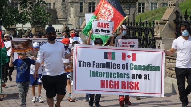 A rally on Parliament Hill calling on the government to speed up and expand its resettlement program for Afghans who assisted Canada in its mission in Afghanistan. (Ashley Burke/CBC - image credit)
