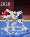 Iran's Nahid Kiyani, left, attacks Kimia Alizadeh Zonoozi, of the Refugee Olympic Team, during the women's 57kg match at the 2020 Summer Olympics, Sunday, July 25, 2021, in Tokyo, Japan. (AP Photo/Themba Hadebe)