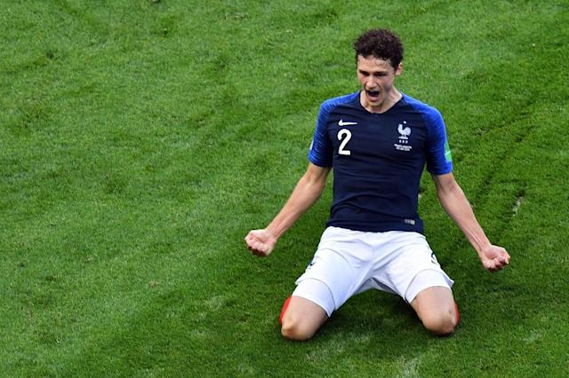 Pavard celebrates after scoring his wonder goal against Argentina in the last 16 (AFP Photo/SAEED KHAN)