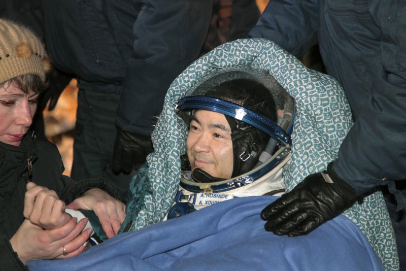 Japanese astronaut Aki Hoshide smiles after landing in a Soyuz capsule outside the town of Arkalyk, Kazakhstan, on Monday, Nov. 19, 2012. Hoshide along with NASA's Sunita Williams, and Russian astronaut Yury Malenchenko touched down in the dark, chilly expanses of central Kazakhstan onboard a Soyuz capsule Monday after a 125-day stay at the International Space Station.  (AP Photo/Maxim Shipenkov, Pool)