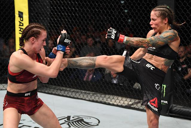 (R-L) Liz Carmouche kicks Lucie Pudilova in their women's flyweight bout during UFC Fight Night at O2 Arena on Feb. 23, 2019 in the Prague, Czech Republic. (Getty Images)