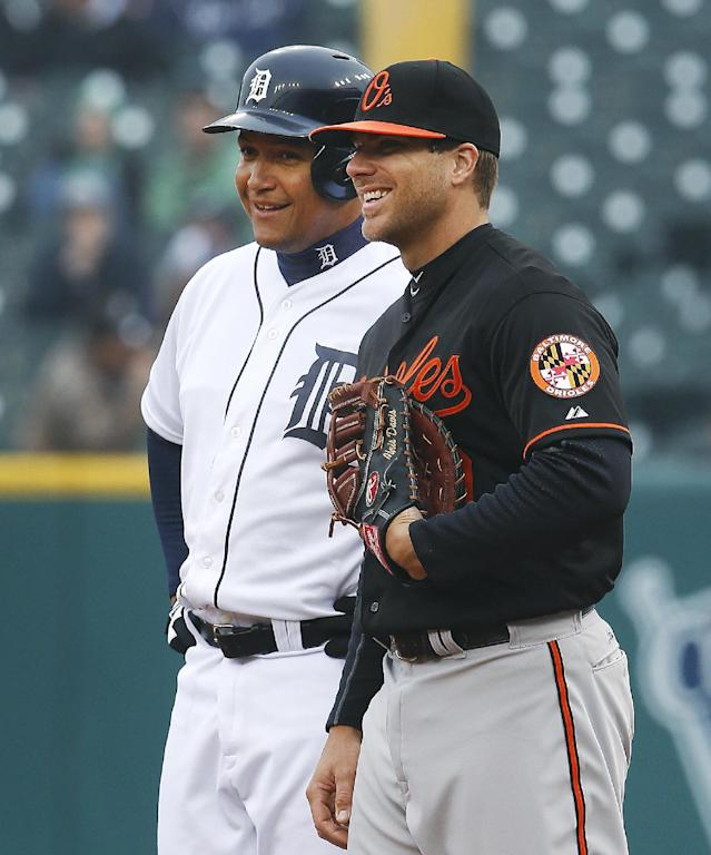 Detroit Tigers' Miguel Cabrera, left, talks with Baltimore Orioles first baseman Chris Davis while on first base in the first inning of a baseball game in Detroit, Friday, April 4, 2014. (AP Photo/Paul Sancya)