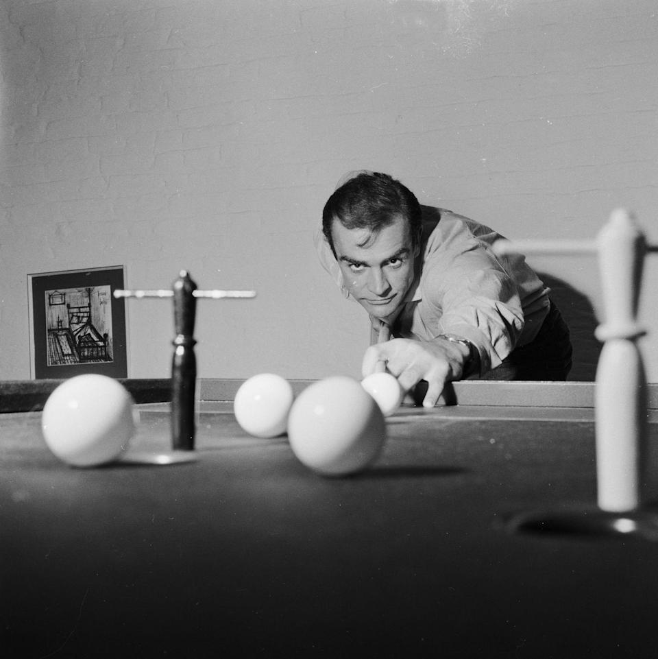 <p>Connery shoots some pool at his basement flat in London's NW8, 1962.</p>