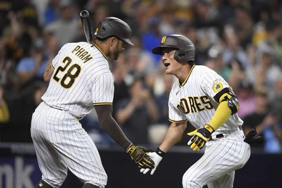 San Diego Padres second baseman Ha-Seong Kim (7) is congratulated by Tommy Pham (28) after hitting a solo home run during the fifth inning of a baseball game against Los Angeles Dodgers Tuesday, June 22, 2021, in San Diego. (AP Photo/Denis Poroy)