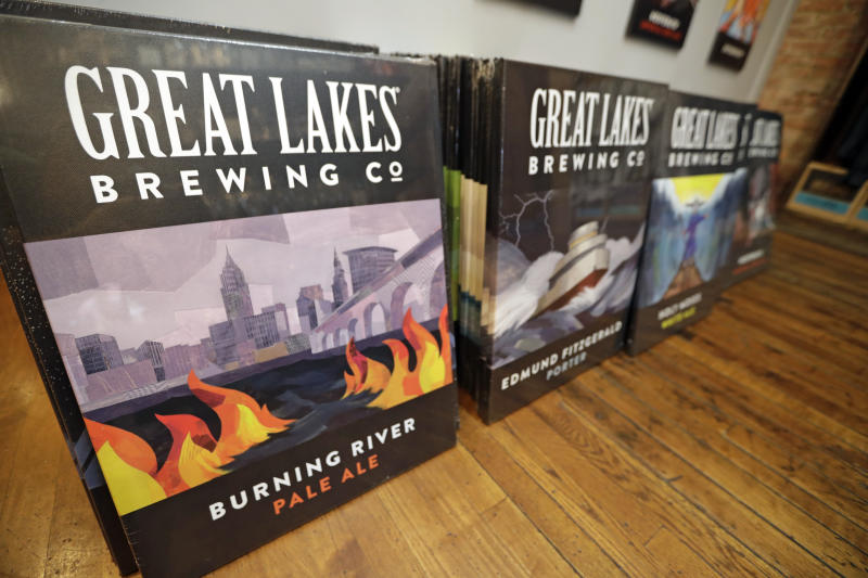 "Posters are for sale featuring Burning River Pale Ale at the gift shop at the Great Lakes Brewing Company, Monday, June 17, 2019, in Cleveland. Fifty years after the Cuyahoga River's famous fire, a plucky new generation of Cleveland artists and entrepreneurs has turned the old jokes about the ""mistake on the lake"" into inspiration and forged the decades of embarrassment into a fiery brand of local pride. (AP Photo/Tony Dejak)"