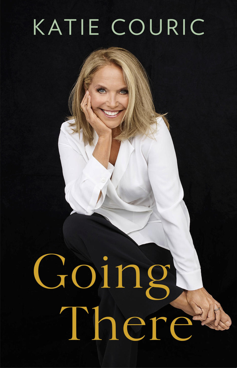 """This cover image released by Little, Brown and Company shows """"Going There,"""" a memoir by Katie Couric, releasing Oct. 26. ( Little, Brown and Company via AP)"""