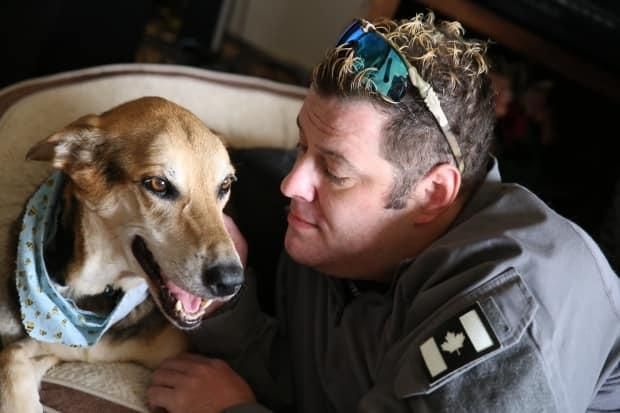 Afghan war vet Geoff Logue with his service dog Luna on Sunday, a day before he put her down.  (Austin Grabish/CBC - image credit)
