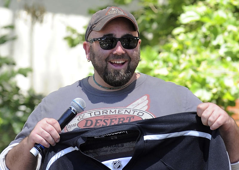 "FILE - In this May 1, 2011 file photo, Duff Goldman, the cake master behind Food Network's reality show ""Ace of Cakes,""  speaks at The Los Angeles Times Festival of Books at the University of Southern California in Los Angeles. YouTube's latest original content channel, HUNGRY, which goes live on July 2, is expected to feature a freewheeling blend of how-to and celebrity-driven food videos. One of the series will feature Goldman's ""Duff's Food World,"" a sometimes irreverent variety show focused on food pop culture, including visits to unusual restaurants and spotlights of humorous food clips from the web and TV. (AP Photo/Katy Winn)"