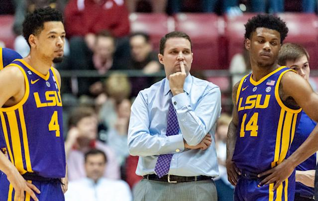 LSU guard Skylar Mays (4), LSU head coach Will Wade and LSU guard Marlon Taylor (14) look on during a referee video review during the first half of an NCAA college basketball game against Alabama, Saturday, March 2, 2019, in Tuscaloosa, Ala. (AP Photo/Vasha Hunt)