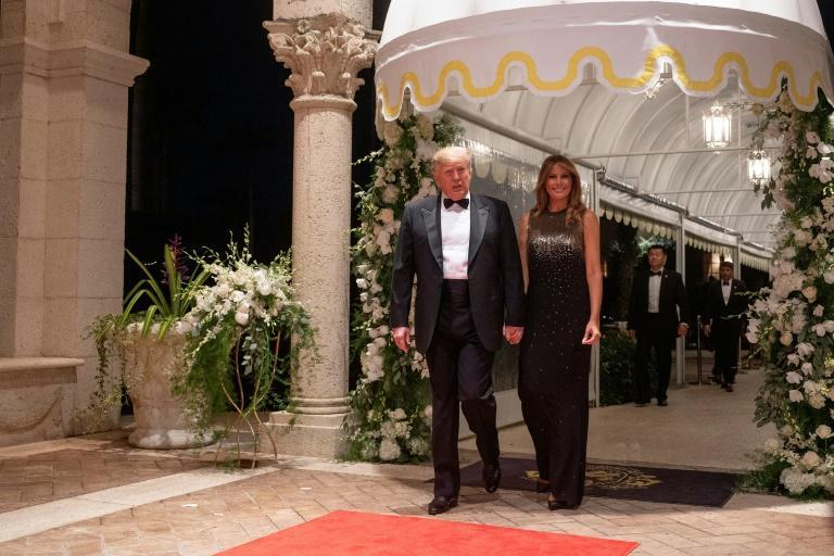 US President Donald Trump and First Lady Melania Trump arrive for a New Year's celebration at Mar-a-Lago in December 2019