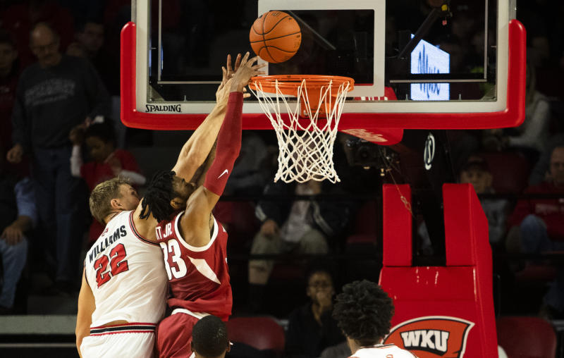 Western Kentucky Hilltoppers forward Carson Williams (22) blocks a shot attempt by Arkansas Razorbacks guard Jimmy Whitt Jr. (33) during WKU's 86-79 win in overtime over Arkansas on Saturday, December 7, 2019, at E. A. Diddle Arena. (Austin Anthony/Daily News via AP)