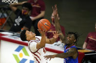 Iowa State guard Rasir Bolton drives to the basket in front of Kansas guard Marcus Garrett, right, during the second half of an NCAA college basketball game, Saturday, Feb. 13, 2021, in Ames, Iowa. Kansas won 64-50. (AP Photo/Charlie Neibergall)