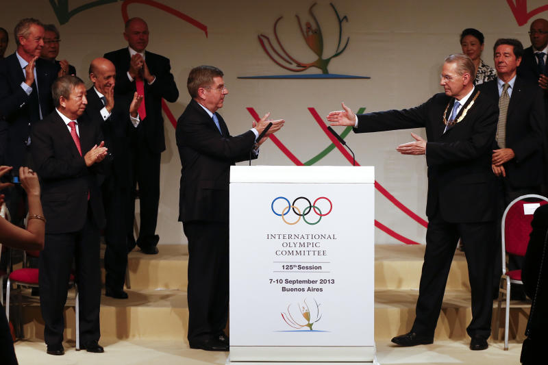 Jacques Rogge, right, outgoing president of the International Olympic Committee (IOC), points to Thomas Bach of Germany, left, after Bach was elected as the new IOC president during the 125th IOC session in Buenos Aires, Argentina, Tuesday, Sept. 10, 2013. (AP Photo/Victor R. Caivano)