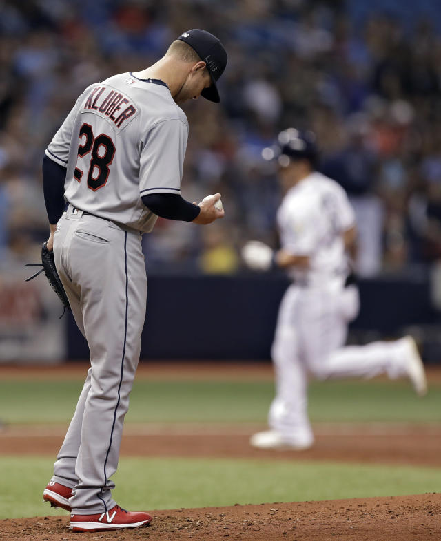 Cleveland Indians pitcher Corey Kluber reacts as Tampa Bay Rays' Jake Bauers, right, runs around the bases after Bauers hit a two-run home run during the second inning of a baseball game Monday, Sept. 10, 2018, in St. Petersburg, Fla. (AP Photo/Chris O'Meara)