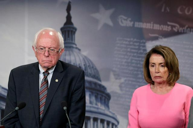<p>U.S. House Minority Leader Nancy Pelosi (D-CA) and Sen. Bernie Sanders (D-VT) react during a news conference on release of the president's FY2018 budget proposal on Capitol Hill in Washington, U.S., May 23, 2017. (Photo: Yuri Gripas/Reuters) </p>